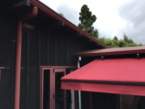 Retractable awning installed under a soffit