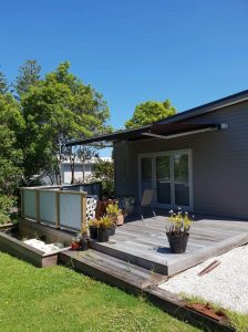 Awning fixed to weatherboard in Maraetai